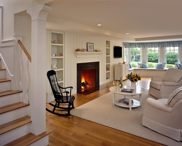 Если интерьер гостиной комнаты украшает камин, его естественным дополнение будет наличие кресел-качалок